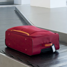 Suitcase on airport conveyor belt